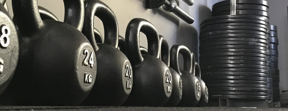 Kettlebell Fitness Training At Out Gym